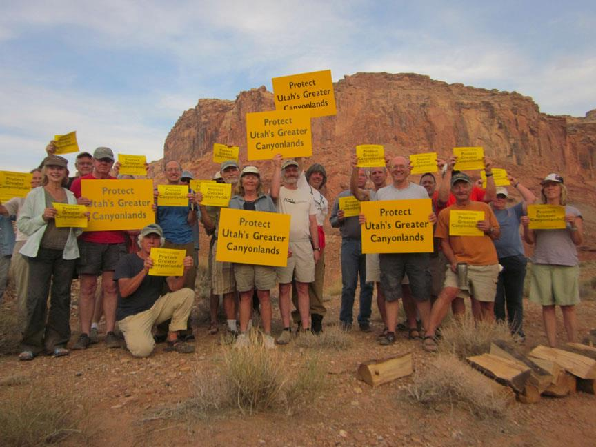 Activists hold signs urging protection of Utah's Greater Canyonlands region